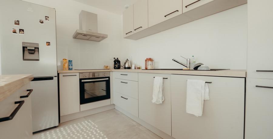 programme immobilier neuf à labastidette : les carrés horizon, duplex-jardin cuisine