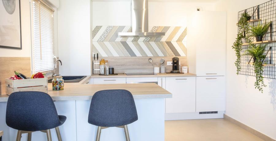Programme immobilier neuf aux Auxons : les Carrés d'Ausona, duplex-jardin cuisine