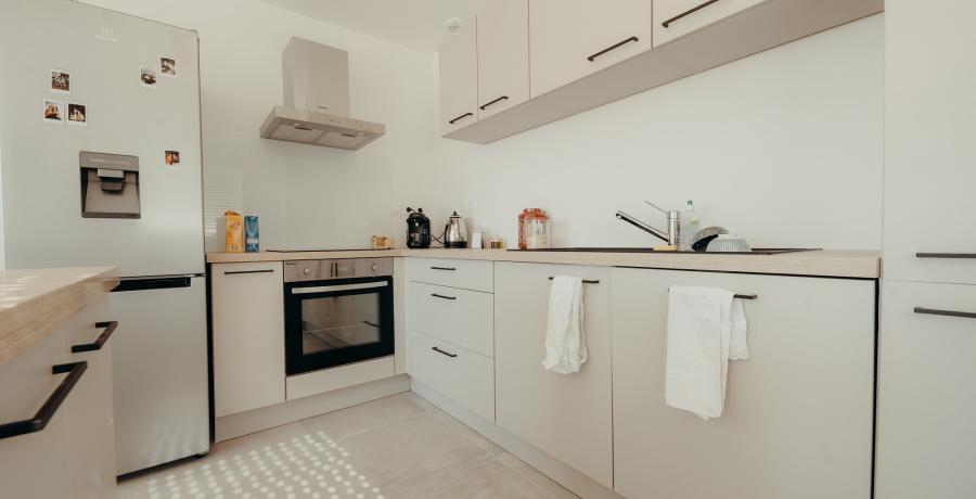 Programme immobilier neuf à Castelmaurou : les Carrés Tolosan, duplex-jardin cuisine